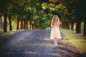 Girl white dress road trees timothy-eberly unsplash